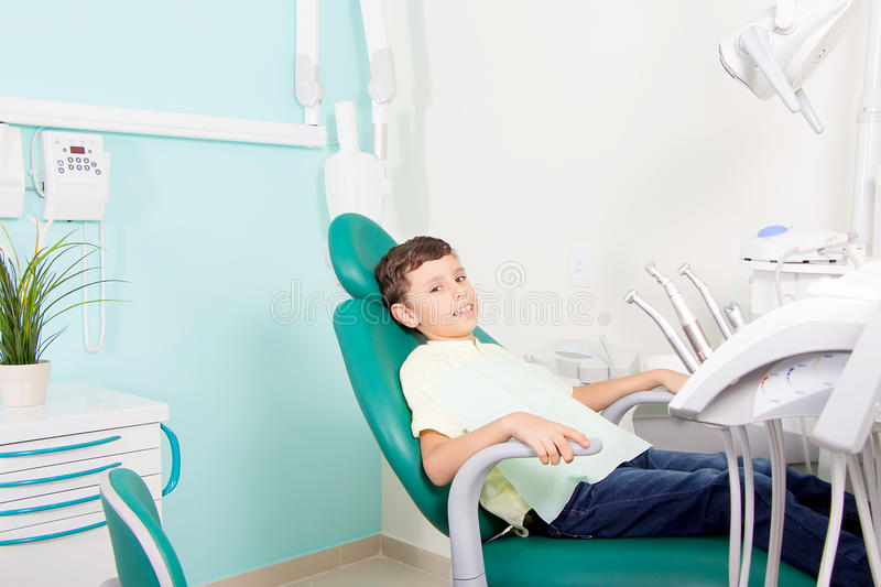 Little kid smiling at dental clinic stock photos