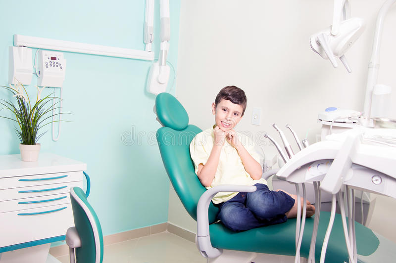 Little kid smiling at dental clinic royalty free stock image