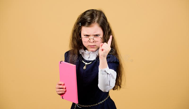 Little kid study. Stressful school day. Education what remains after one has forgotten what one has learned school. Back. To school. Knowledge day. Serious royalty free stock photos