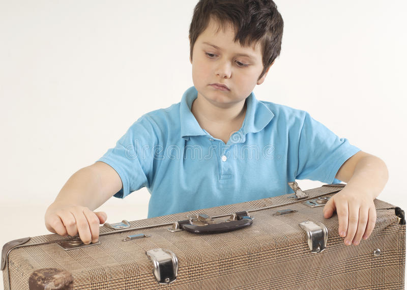 Little kid with a suitcase royalty free stock photo