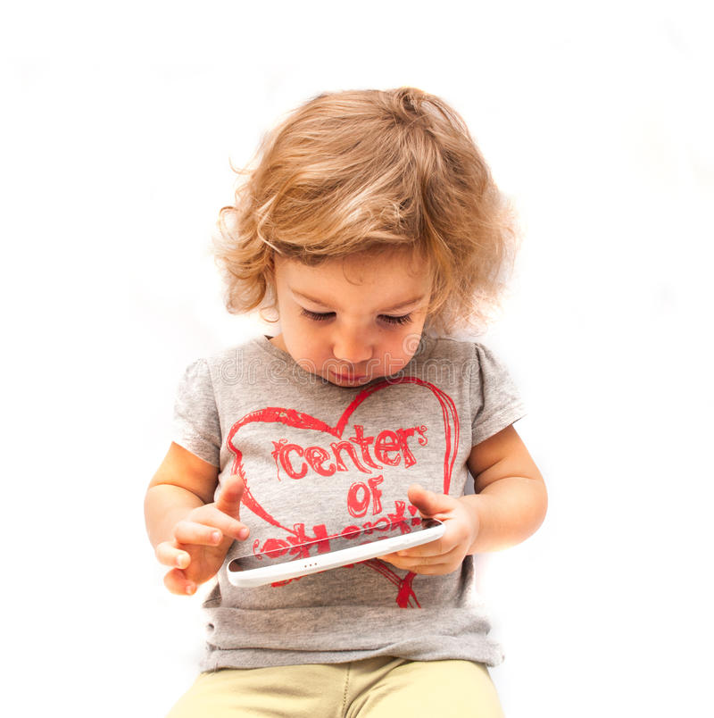 Little Kid Swiping White Smartphone Stock Photography