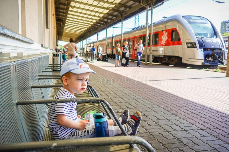 Little kid in a train station royalty free stock image