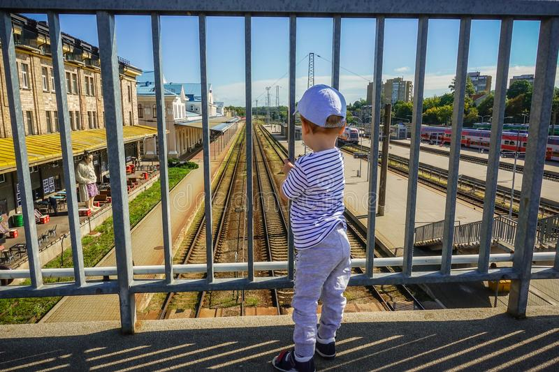 Little kid in a train station stock image