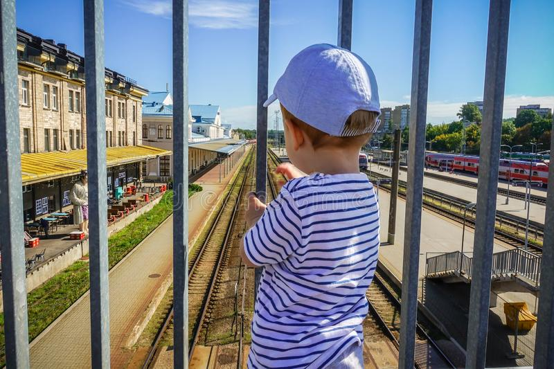 Little kid in a train station royalty free stock photography