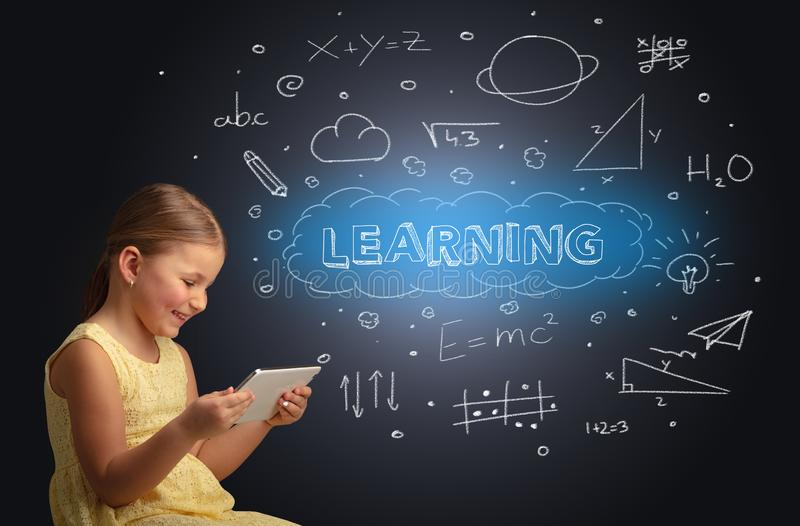 Little kid using on tablet with educational concept royalty free stock images
