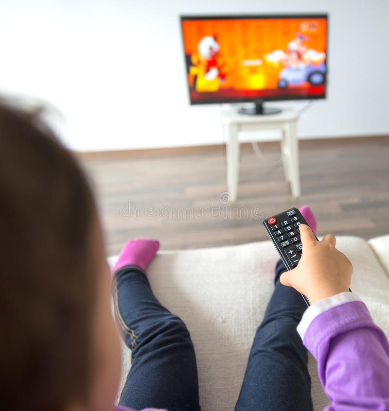 Little kid watching TV in the living room royalty free stock photo