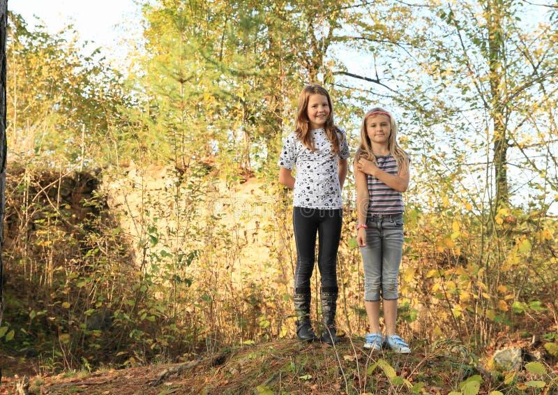 Little kids - girls among ruins royalty free stock photography