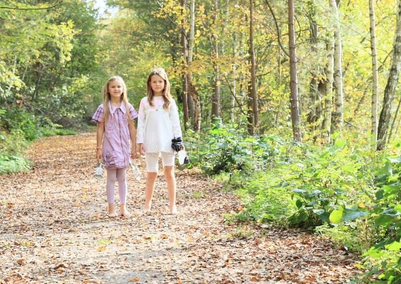 Little kids - girls standing barefoot stock images