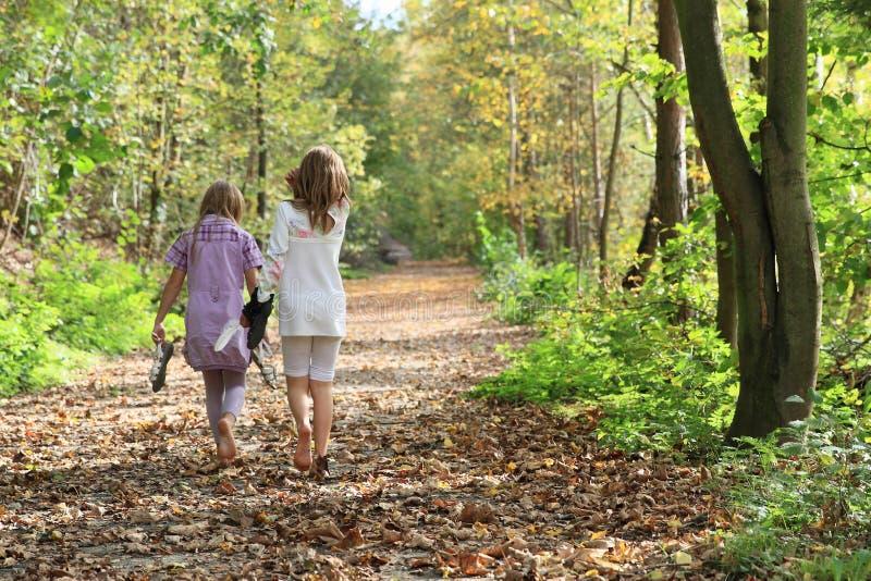 Little kids - girls walking barefoot stock photo