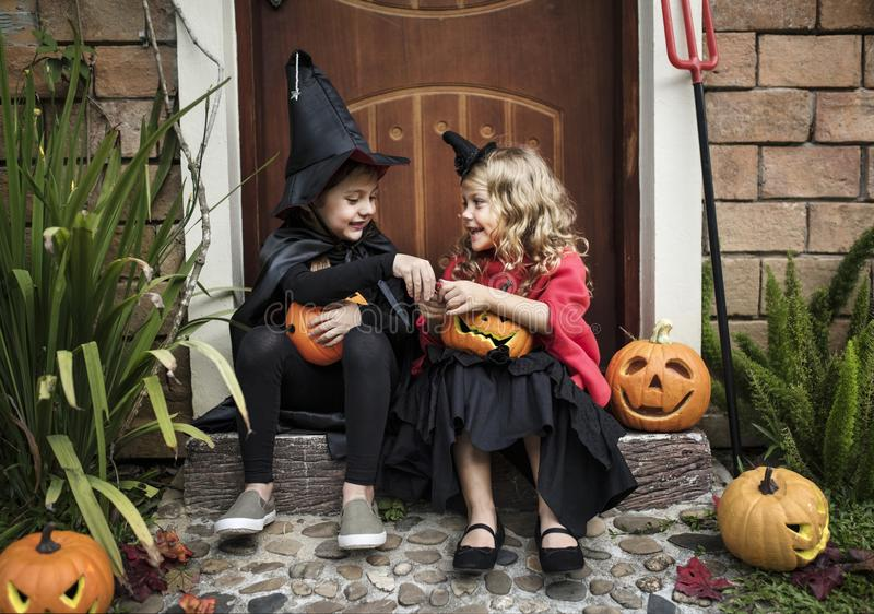 Little kids at a Halloween party stock photography