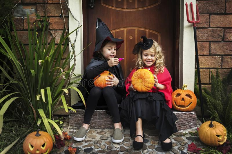 Little kids at a Halloween party stock image