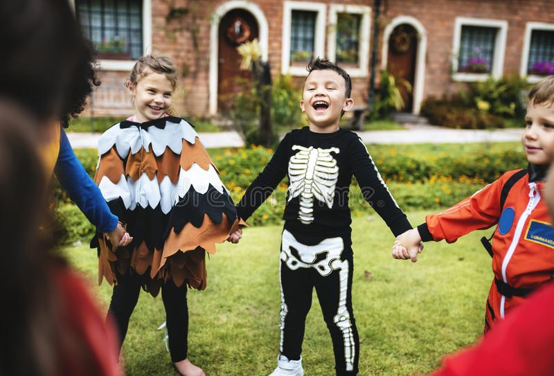 Little kids at a Halloween party royalty free stock photo