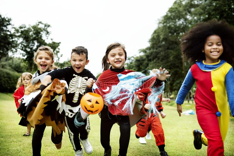 Little kids at a Halloween party royalty free stock photography