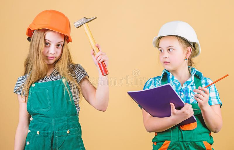 Little kids in helmet with hammer. Labor day. 1 may. happy children. Future career. Foreman inspector. Repair. small royalty free stock photography