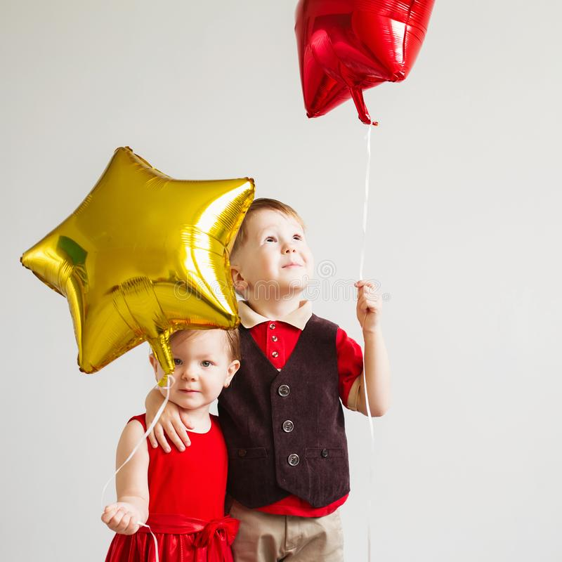 Little kids holding balloons in the form of stars. royalty free stock images