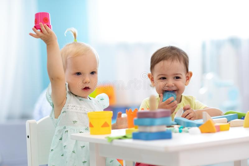 Little kids play in nursery. Developmental toys for preschool. royalty free stock image