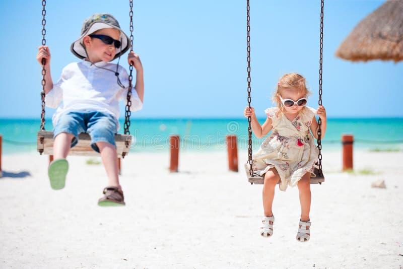 Little kids swinging royalty free stock photos