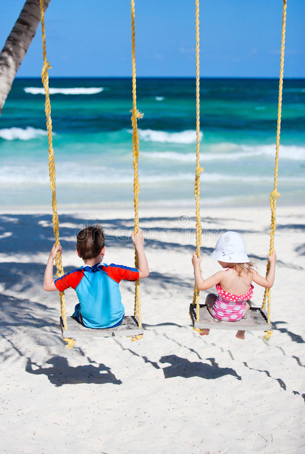 Download Little kids swinging stock image. Image of happy, beach - 20493205