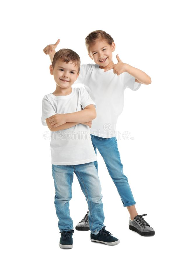 Little kids in t-shirts on white background. Mockup for design royalty free stock image