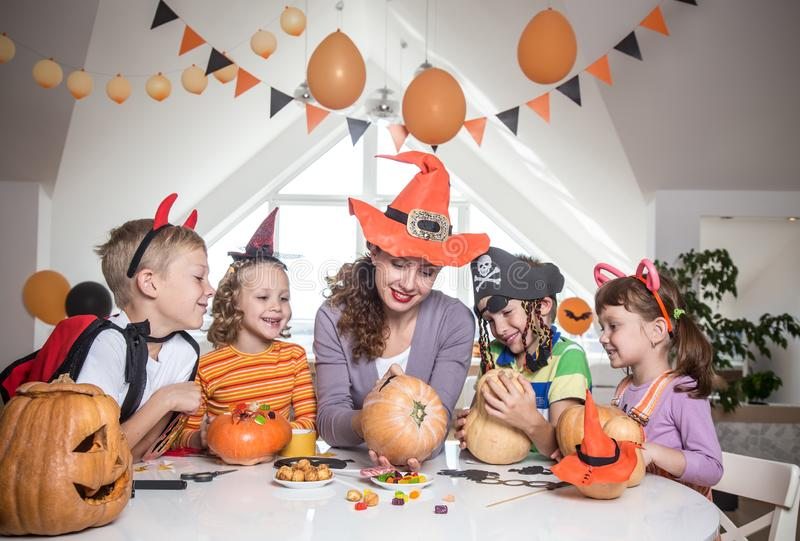 Family in Halloween party stock images