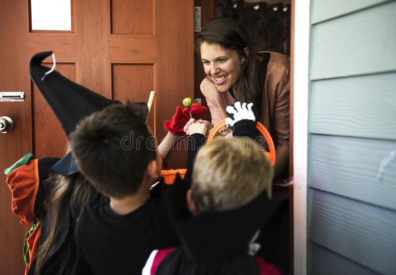 Little kids trick or treating royalty free stock photos