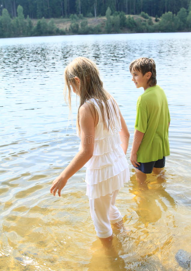Little kids in water royalty free stock image
