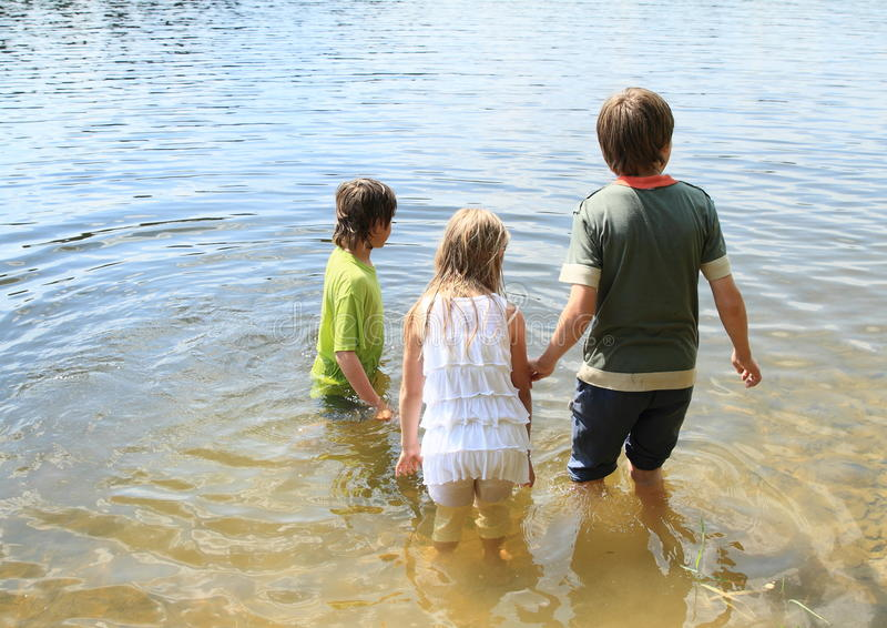 Little kids in water royalty free stock photo