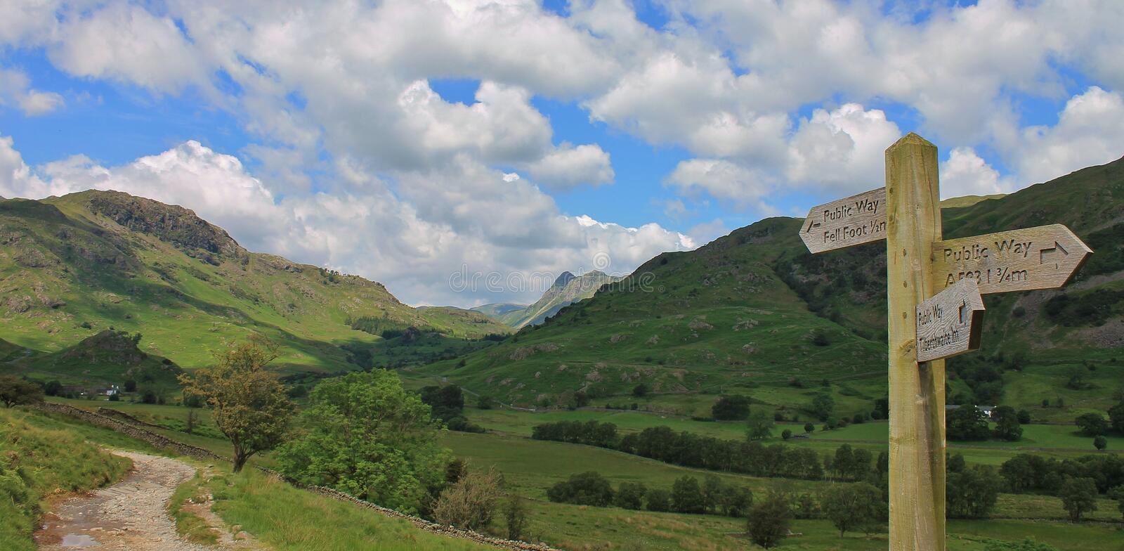 Little Langdale Valley Cumbria UK. View towards the distant Langdale Pikes from the Little Langdale Valley in the English Lake District Cumbria UK royalty free stock image