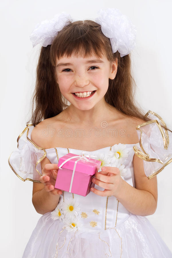 Download Little Laughing Girl Holding Christmas Present Stock Image - Image: 21932621