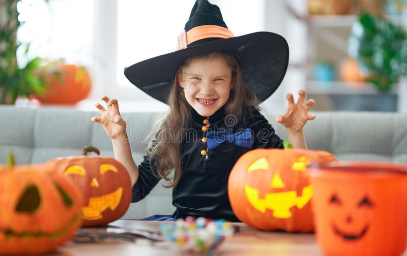 Little laughing girl in witch costume royalty free stock photography