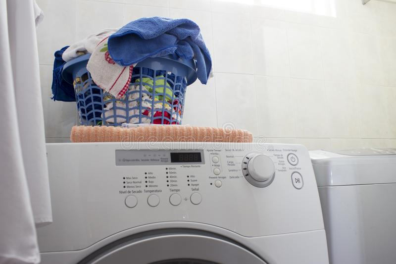 Clean laundry basket over the washing machine. stock photos