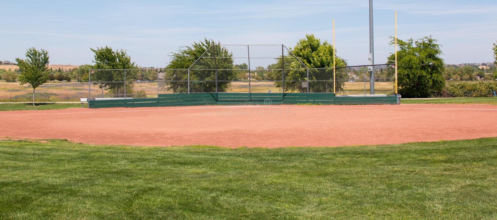 Little League Baseball Field. With green grass, brown dirt and no people royalty free stock photo
