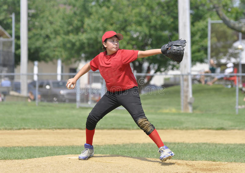 Little league baseball pitcher. On the pitcher's mound royalty free stock photo