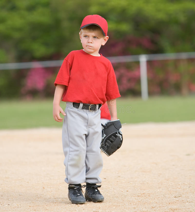 Little League Baseball Player. Standing on the infield stock photography