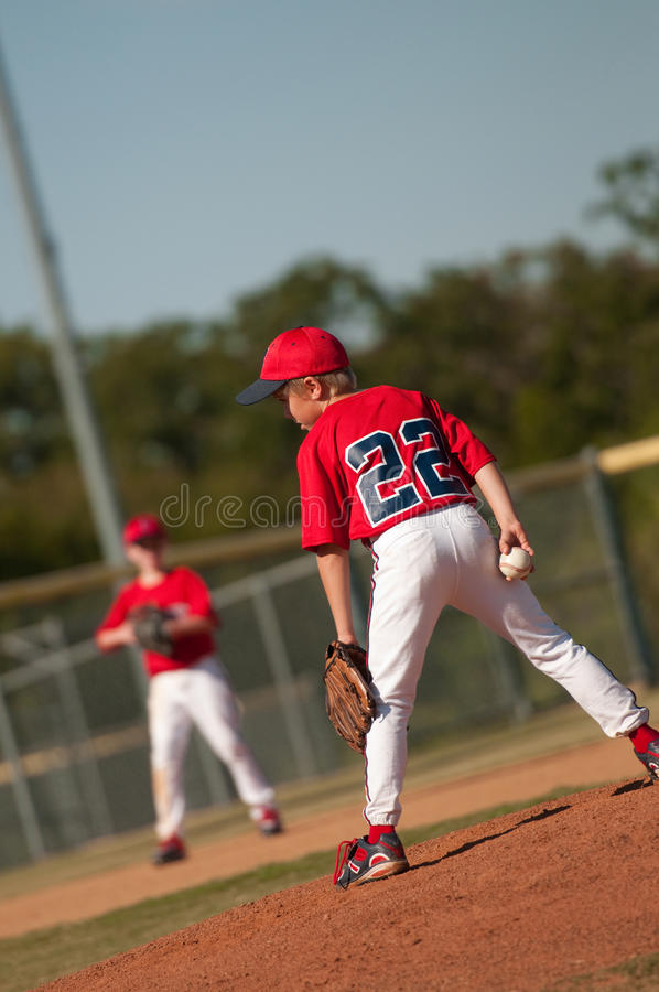 Little league baseball pitcher looking at batter. stock photo