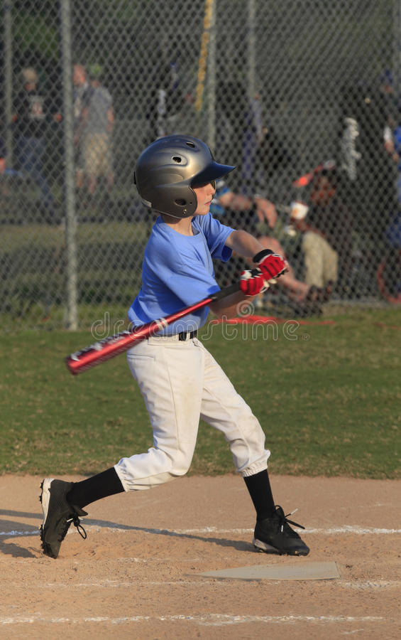 Little league Batter Begins His Swing at a Pitch stock photo