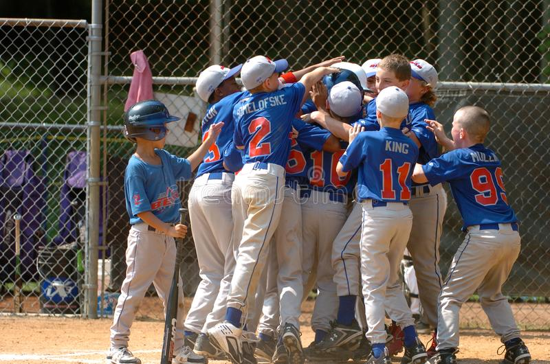 Little League Baseball Game. Little League Players Celebrating A Game Winning Home Run stock images