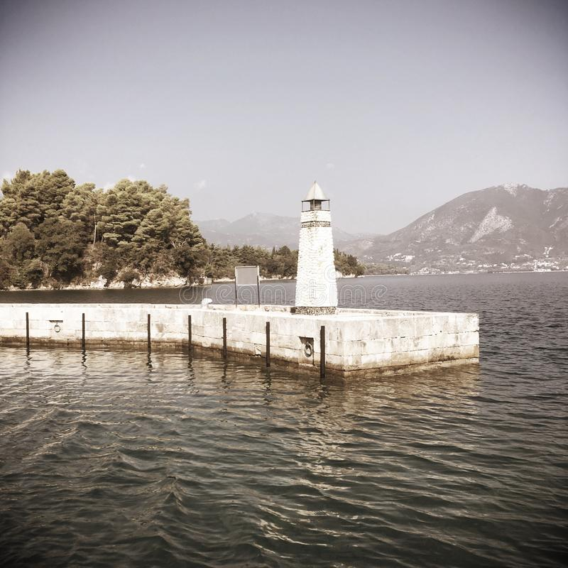 Little Lighthouse on the island. A little model of lighthouse in the port of island Meganisi, Lefkada, Greece stock images