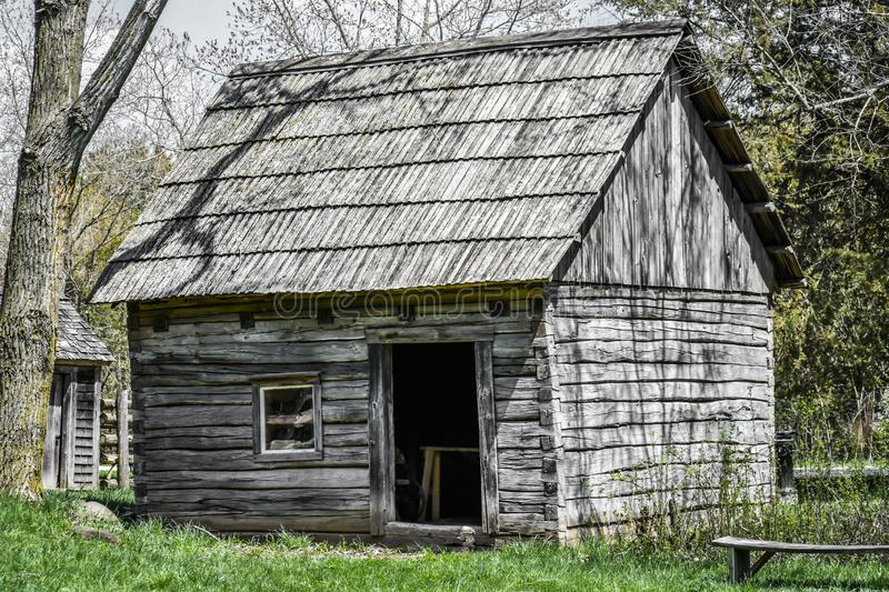 Little Wooden House in the Woods with Open Door royalty free stock image