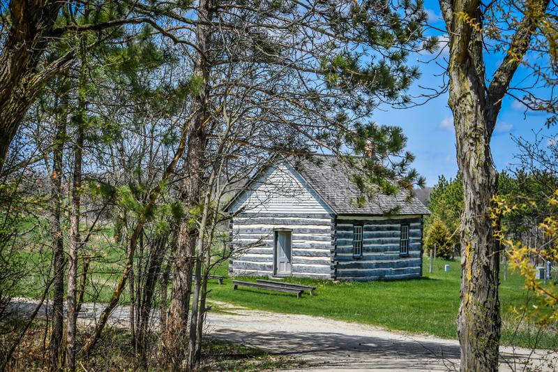 Little Wooden House in the Woods with Open Door stock photos