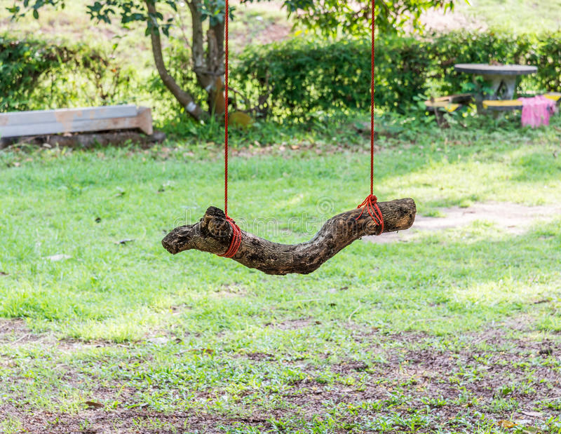 Little log swing royalty free stock images