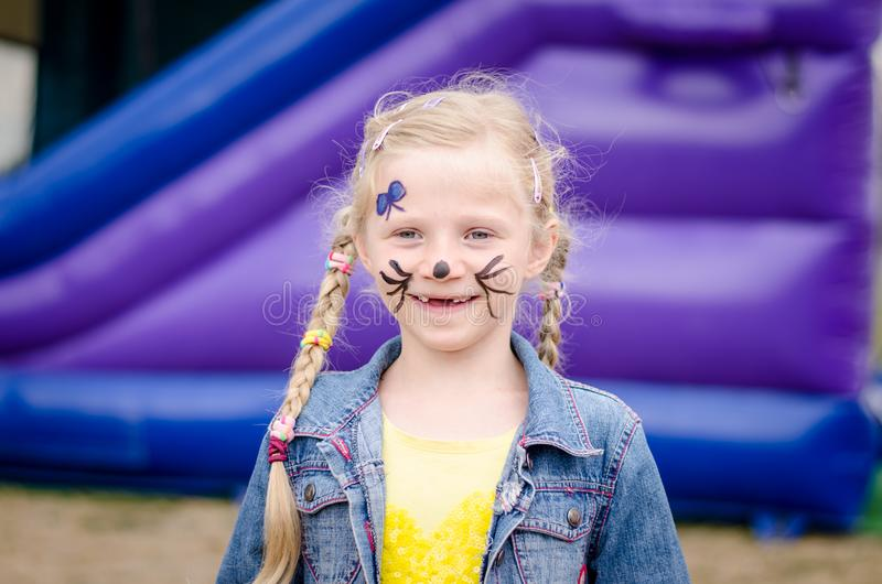 Little lovely child with face painting smiling stock photo