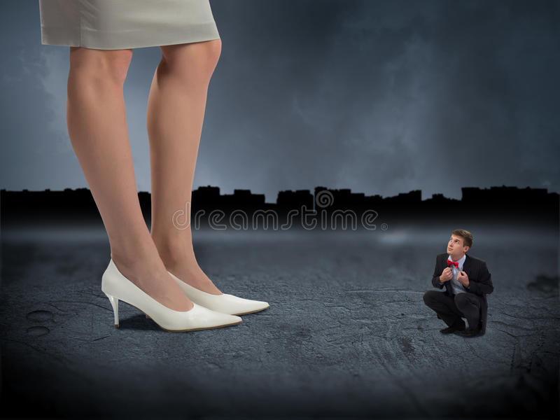 Little man and woman boss stock images