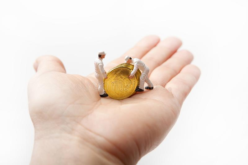 Little men in uniform with Russian coins in the palm. royalty free stock photography