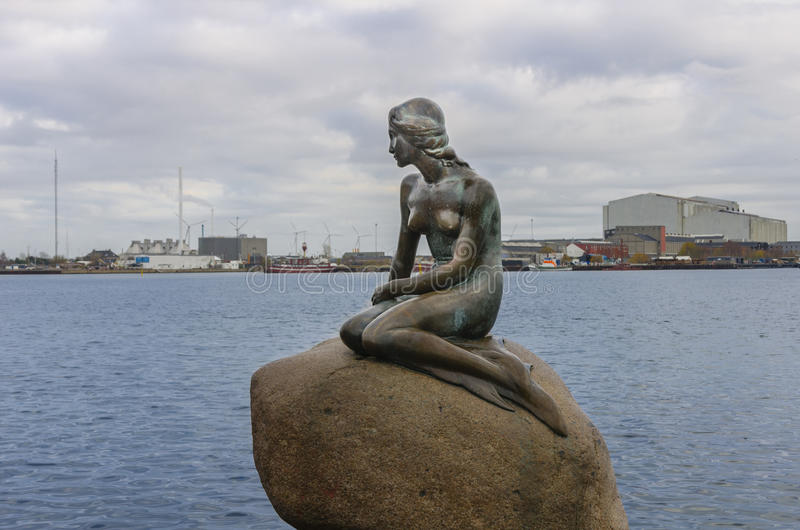 The Little Mermaid. (Danish: Den lille havfrue) is a bronze statue by Edvard Eriksen, depicting a mermaid. The sculpture is displayed on a rock by the waterside royalty free stock images