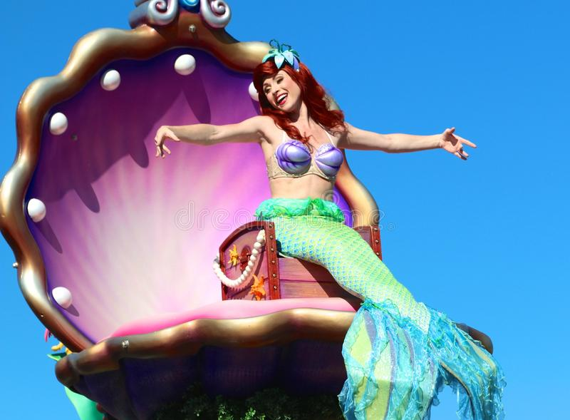 Mermaid at Disney's Magic Kingdom. The Little Mermaid smiles and waves as she rides a float at Disney's Magic Kingdom royalty free stock images