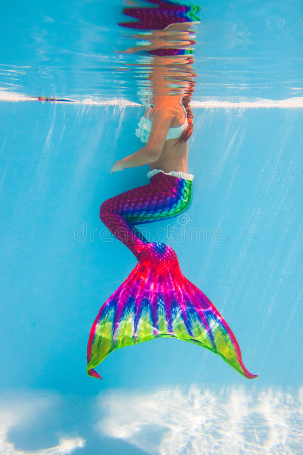 Little Mermaid underwater. Little Mermaid with colorful tail, underwater photography in pool stock image