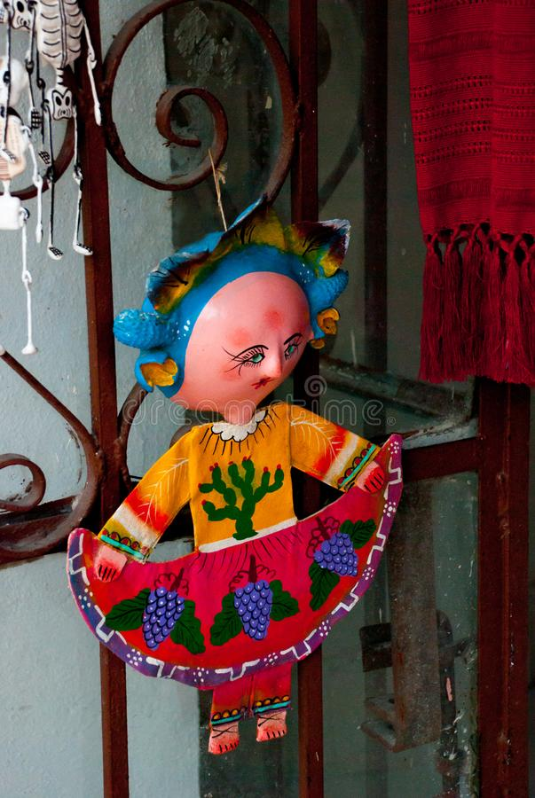 Little Mexican dolls in traditional dress at the Souvenir shop, popular place for the tourists who visit the country royalty free stock images