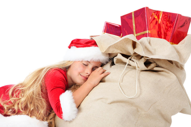 Little miss santa asleep on the sack of gifts