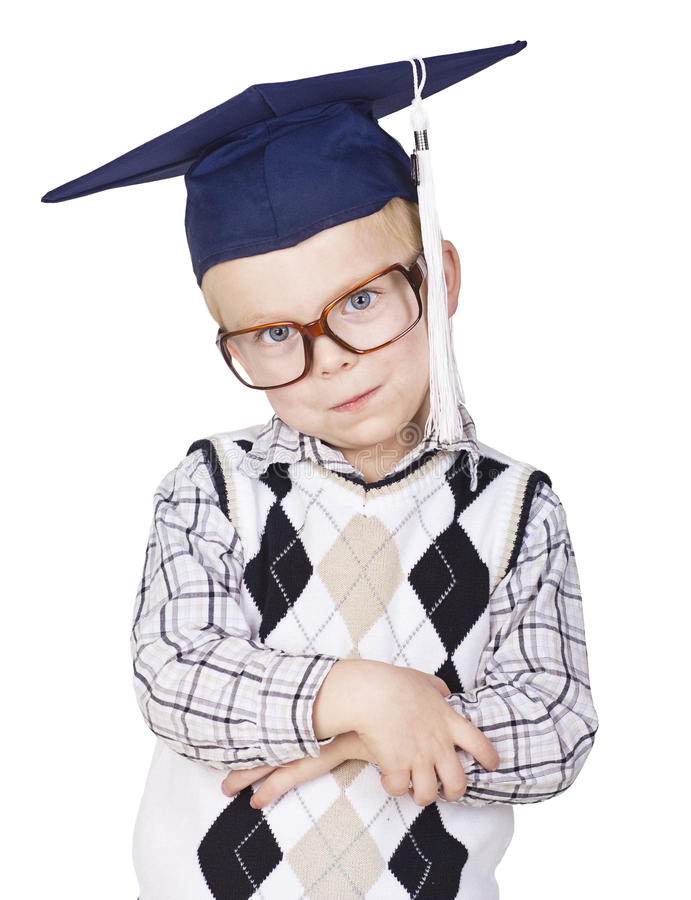 Little Mister Smarty Pants. A young boy nerd looking smart and wearing a graduation cap. Isolated on white background stock photo